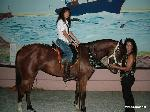 A beautiful rider on her horse, with her mother.  The horse