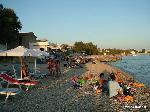 On the beach of Agios Isidoros with the sun setting for the