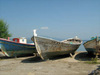 A group of boats in Methoni decorate the beach front.