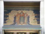 An art deco work on a building on 6th avenue in the