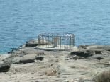 A baptismal font set on the jetty on the mediterranean.
